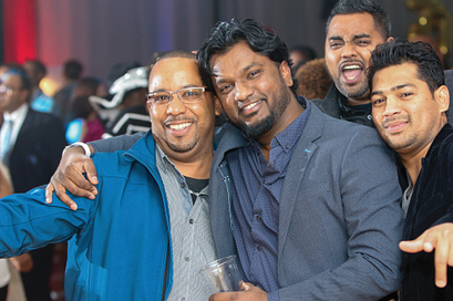 centennial college alumni smiling and posing on the dance floor at a homecoming event