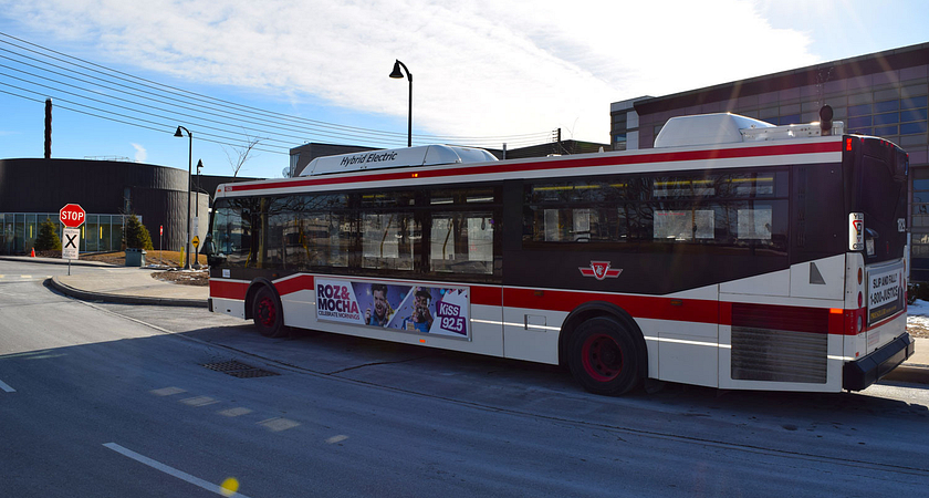 A TTC bus driving through the streets