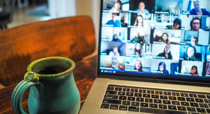 a coffee cup and laptop displaying an online course